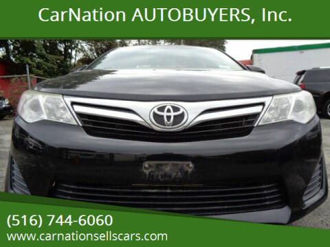 2013 Toyota Camry for sale at CarNation AUTOBUYERS, Inc. in Rockville Centre NY