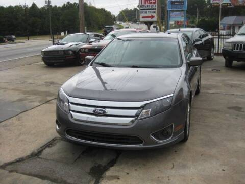 2012 Ford Fusion Hybrid for sale at LAKE CITY AUTO SALES in Forest Park GA