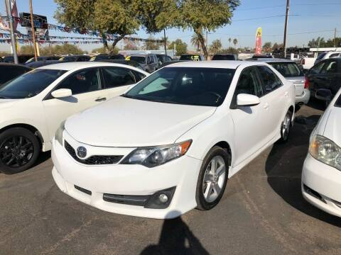 2013 Toyota Camry for sale at Valley Auto Center in Phoenix AZ
