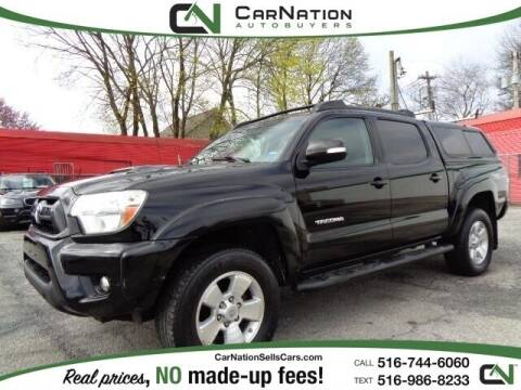 2014 Toyota Tacoma for sale at CarNation AUTOBUYERS, Inc. in Rockville Centre NY