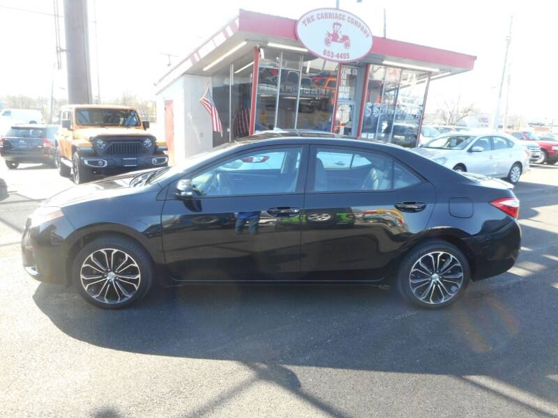 2014 Toyota Corolla for sale at The Carriage Company in Lancaster OH