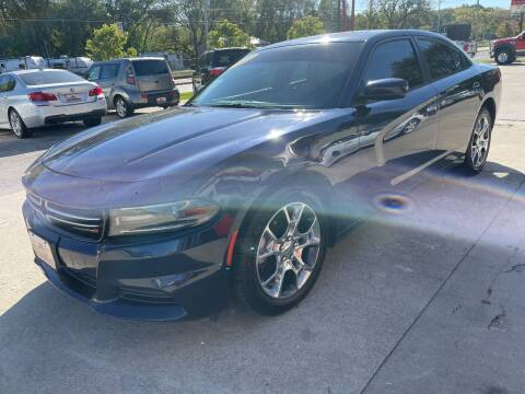 2015 Dodge Charger for sale at Azteca Auto Sales LLC in Des Moines IA