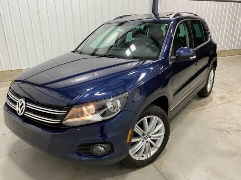 2012 Volkswagen Tiguan for sale at EUROPEAN AUTOHAUS, LLC in Holland MI