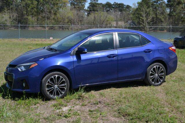 2014 Toyota Corolla for sale at WOODLAKE MOTORS in Conroe TX