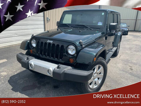 2012 Jeep Wrangler Unlimited for sale at Driving Xcellence in Jeffersonville IN