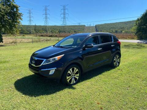 2011 Kia Sportage for sale at Tennessee Valley Wholesale Autos LLC in Huntsville AL