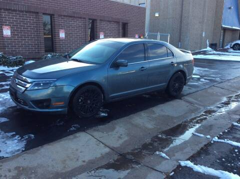 2012 Ford Fusion for sale at AROUND THE WORLD AUTO SALES in Denver CO