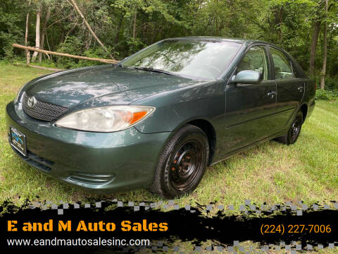 2002 Toyota Camry for sale at E and M Auto Sales in Elgin IL