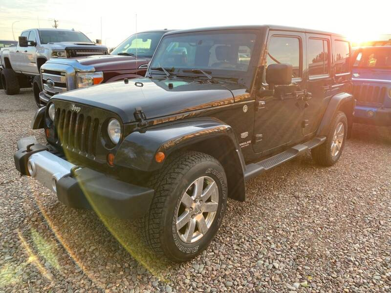 2011 Jeep Wrangler Unlimited for sale at Truck Buyers in Magrath AB