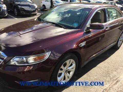 2011 Ford Taurus for sale at J & M Automotive in Naugatuck CT