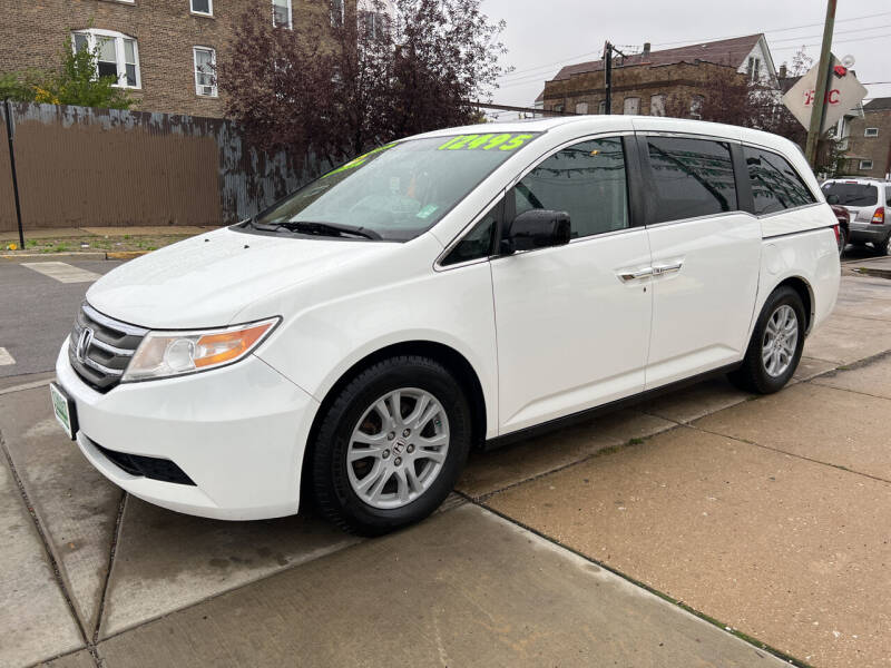 2012 Honda Odyssey for sale at Barnes Auto Group in Chicago IL