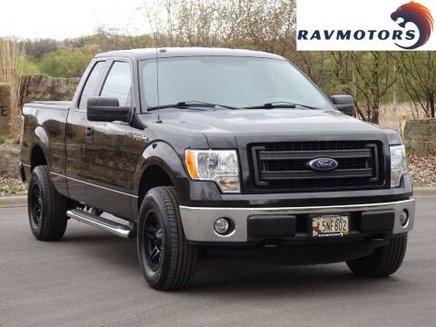 2013 Ford F-150 for sale at RAVMOTORS in Burnsville MN