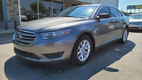 2014 Ford Taurus for sale at Tri City Auto Mart in Lexington KY