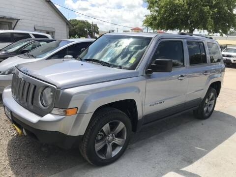 2016 Jeep Patriot for sale at AMIGO USED CARS in Houston TX