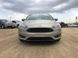 2016 Ford Focus for sale at BERG AUTO MALL & TRUCKING INC in Beresford SD