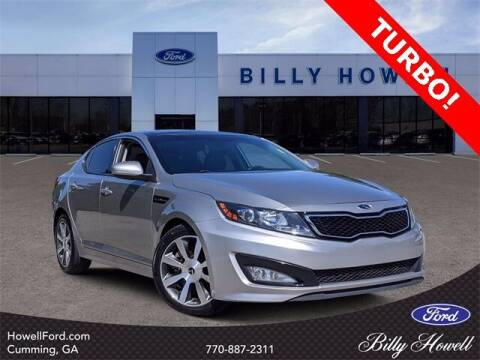 2013 Kia Optima for sale at BILLY HOWELL FORD LINCOLN in Cumming GA