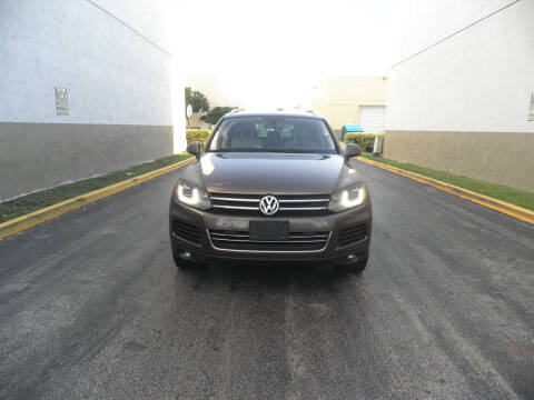 2011 Volkswagen Touareg for sale at INTERNATIONAL AUTO BROKERS INC in Hollywood FL