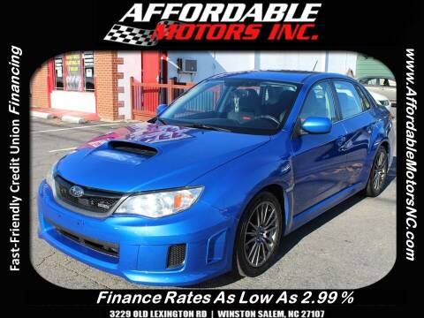 2014 Subaru Impreza for sale at AFFORDABLE MOTORS INC in Winston Salem NC