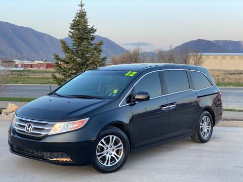 2012 Honda Odyssey for sale at Evolution Auto Sales LLC in Springville UT