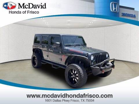 2016 Jeep Wrangler Unlimited for sale at DAVID McDAVID HONDA OF IRVING in Irving TX