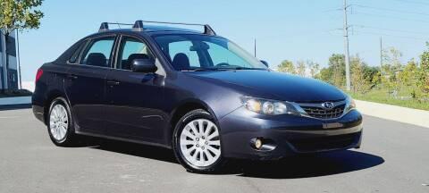 2009 Subaru Impreza for sale at BOOST MOTORS LLC in Sterling VA