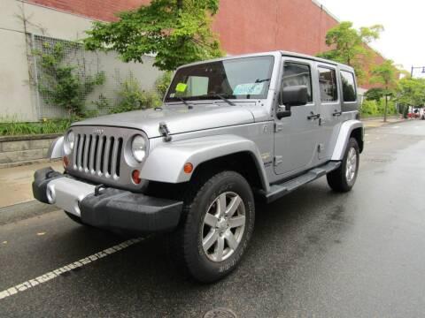 2013 Jeep Wrangler Unlimited for sale at Boston Auto Sales in Brighton MA