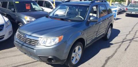 2009 Subaru Forester for sale at Howe's Auto Sales in Lowell MA