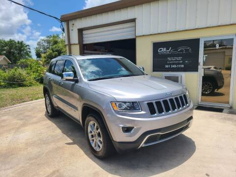 2015 Jeep Grand Cherokee for sale at O & J Auto Sales in Royal Palm Beach FL