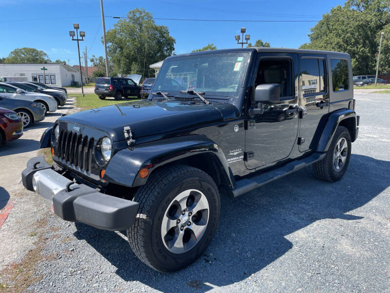 2010 Jeep Wrangler Unlimited for sale at LAURINBURG AUTO SALES in Laurinburg NC