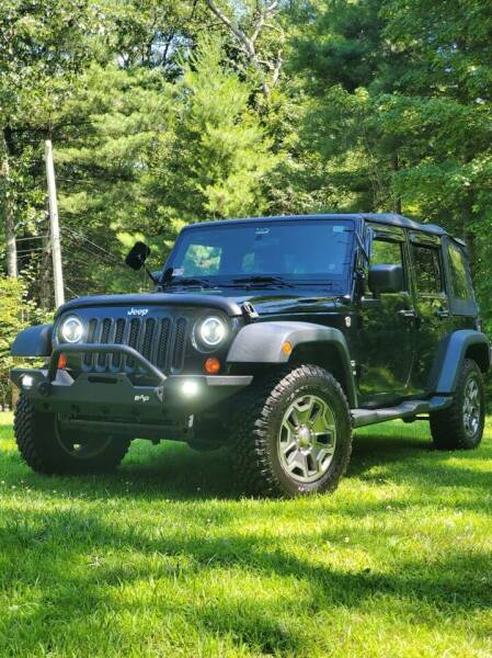 2012 Jeep Wrangler Unlimited for sale at SODA MOTORS AUTO SALES LLC in Newport RI