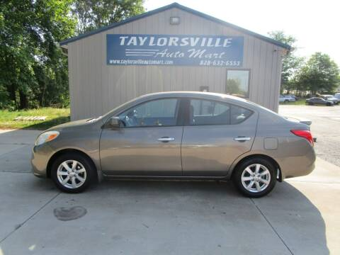 2014 Nissan Versa for sale at Taylorsville Auto Mart in Taylorsville NC