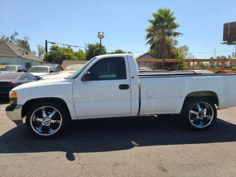 2014 RAM Ram Pickup 1500 for sale at E and M Auto Sales in Bloomington CA
