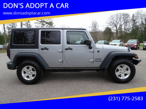 2014 Jeep Wrangler Unlimited for sale at DON'S ADOPT A CAR in Cadillac MI