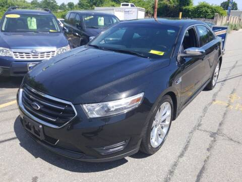 2013 Ford Taurus for sale at Howe's Auto Sales in Lowell MA