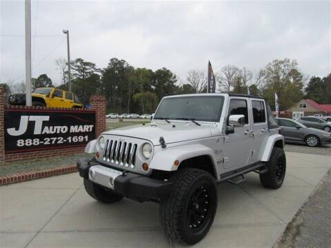2011 Jeep Wrangler Unlimited for sale at J T Auto Group in Sanford NC