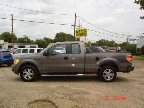 2009 Ford F-150 for sale at A-1 Auto Sales in Conroe TX