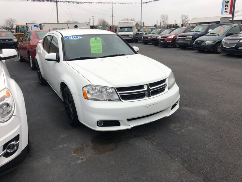 2013 Dodge Avenger for sale at American Auto Group LLC in Saginaw MI