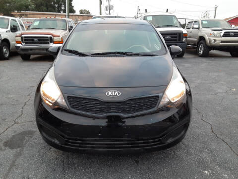 2015 Kia Rio for sale at LOS PAISANOS AUTO & TRUCK SALES LLC in Peachtree Corners GA
