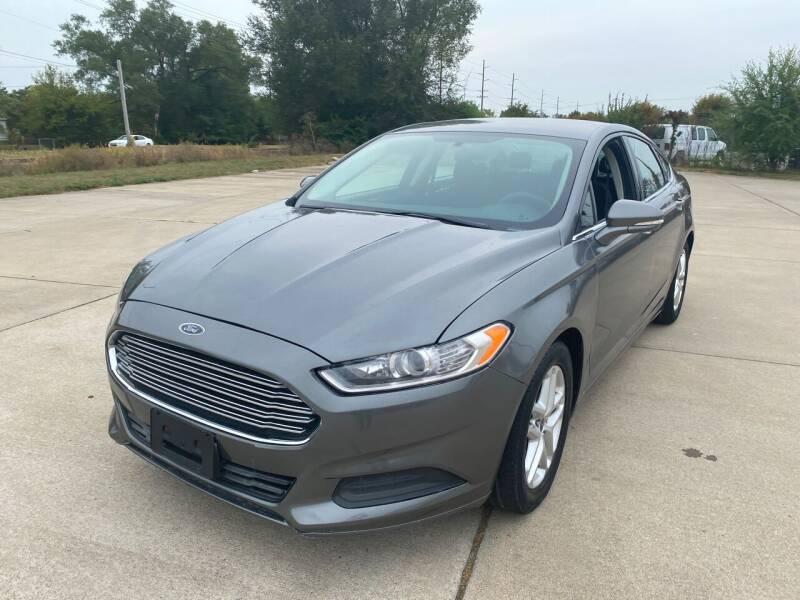 2014 Ford Fusion for sale at Mr. Auto in Hamilton OH