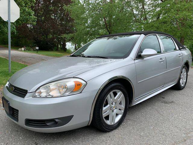2011 Chevrolet Impala for sale at NEW ENGLAND AUTO CENTER in Lowell MA