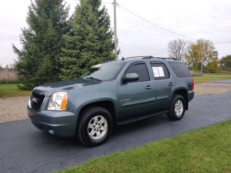 2009 GMC Yukon for sale at Carmart Auto Sales Inc in Schoolcraft MI