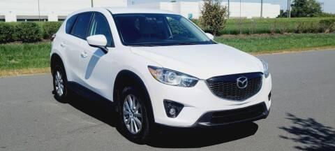 2014 Mazda CX-5 for sale at BOOST MOTORS LLC in Sterling VA