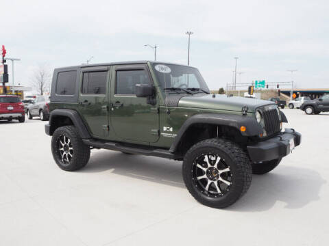 2007 Jeep Wrangler Unlimited for sale at SIMOTES MOTORS in Minooka IL