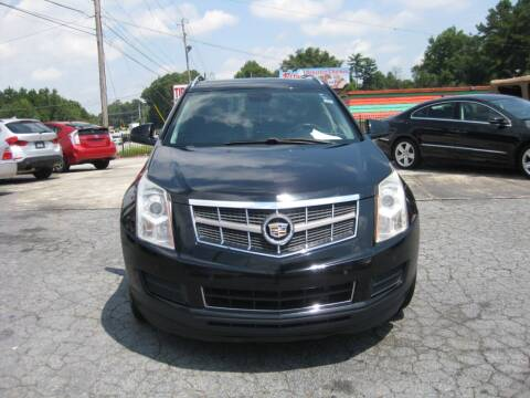 2011 Cadillac SRX for sale at LAKE CITY AUTO SALES in Forest Park GA