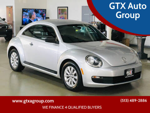 2014 Volkswagen Beetle for sale at GTX Auto Group in West Chester OH