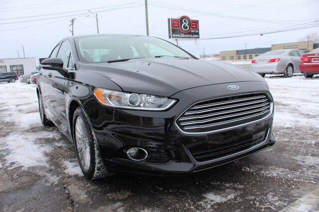 2014 Ford Fusion Hybrid for sale at B & B Car Co Inc. in Clinton Twp MI
