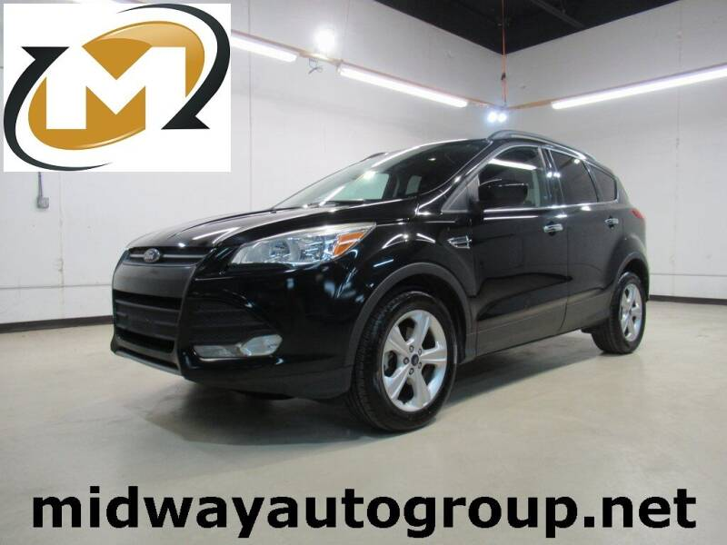 2015 Ford Escape for sale at Midway Auto Group in Addison TX