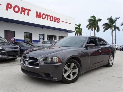 2014 Dodge Charger for sale at Automotive Credit Union Services in West Palm Beach FL