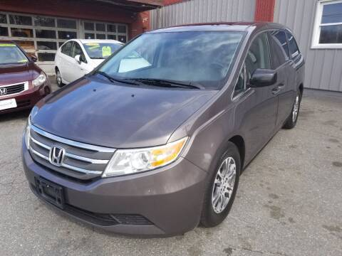 2011 Honda Odyssey for sale at Howe's Auto Sales in Lowell MA