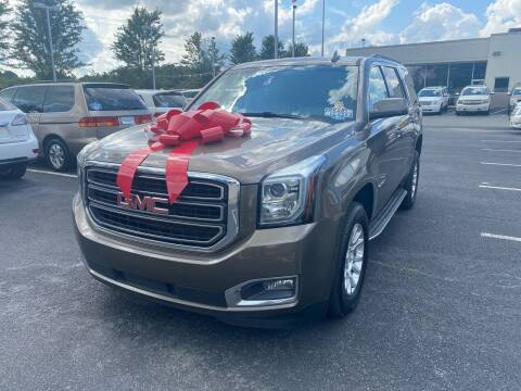 2016 GMC Yukon for sale at Charlotte Auto Group, Inc in Monroe NC